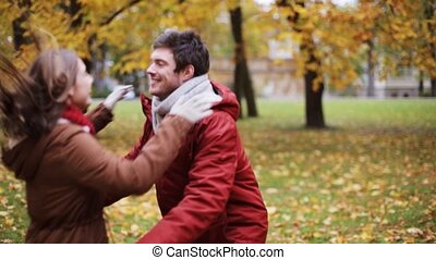 happy young couple meeting in autumn park
