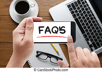 FAQs Frequently Asked Questions message on hand holding to...