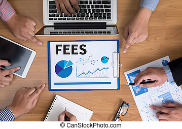 FEES Business team hands at work with financial reports and...