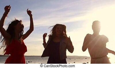 group of happy women or girls dancing on beach 47 - summer...