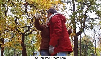 happy young couple hugging in autumn park - love,...