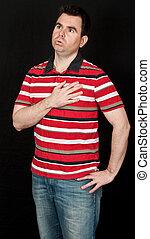 male having chest pain on black backdrop - photo male having...
