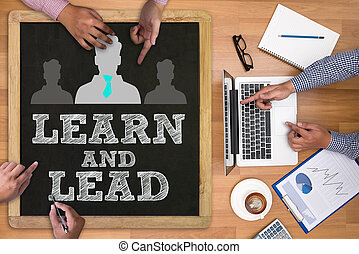 LEARN AND LEAD Businessman working at office desk and using...