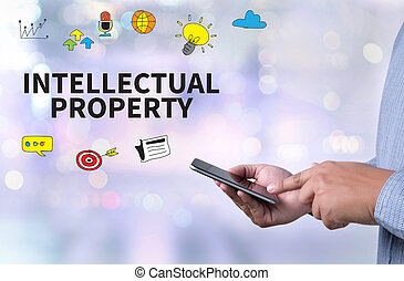 INTELLECTUAL PROPERTY person holding a smartphone on blurred...