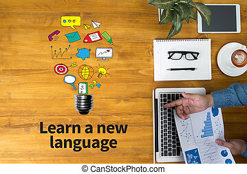 Learn a new language Businessman working at office desk and...