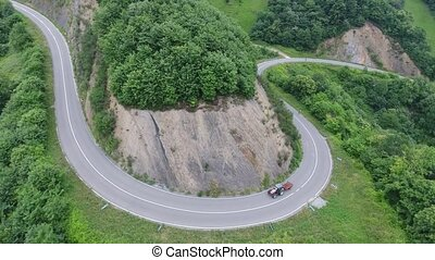 U-shape road and tractor - Aerial view of U-shape road and...