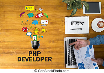PHP DEVELOPER Businessman working at office desk and using...