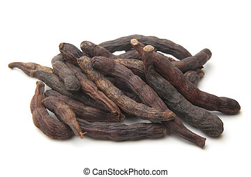 Grains of Selim (Senegal pepper) on white background