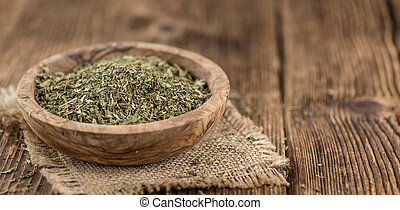 Portion of Stevia Leaves (dried, close-up shot) on wooden...