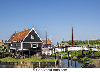 Wooden houses at the lake in Enkhuizen, Holland