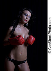 Sexy boxer - Twenty something women holding her breast with...