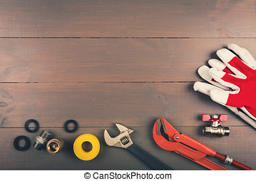 plumbing tools on wooden table with copyspace