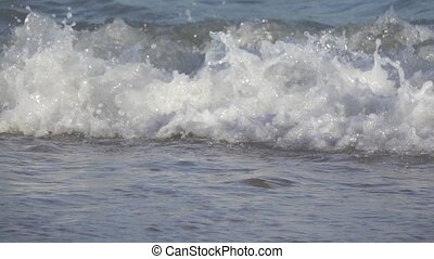Water surface splashing in slow motion - Closeup of sea...