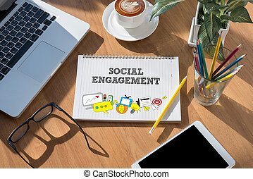 SOCIAL ENGAGEMENT open book on table and coffee Business