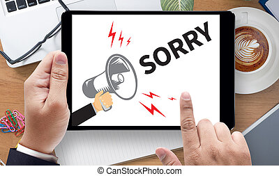 SORRY, on the tablet pc screen held by businessman hands -...