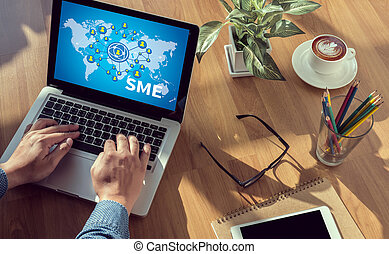 SME or Small and medium-sized enterprises man hand on table...