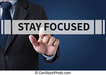 STAY FOCUSED Businessman hands touching on virtual screen...
