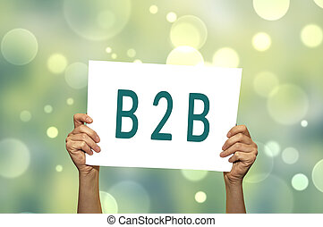B2B (marketing) card in hand with abstract light background....