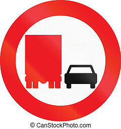 Road sign used in Denmark - No overtaking by lorries.