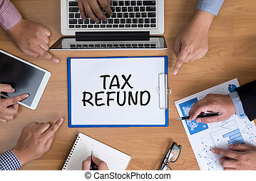 TAX REFUND Business team hands at work with financial...