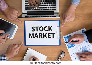 STOCK MARKET Business team hands at work with financial...