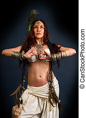 Native savage woman - Performance. Young attractive retro...