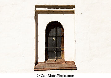 Gothic castle. The old prison wall window with iron bars -...