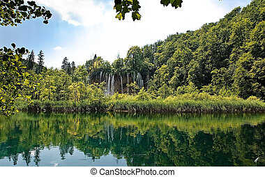 Lake and waterfall in deep forest
