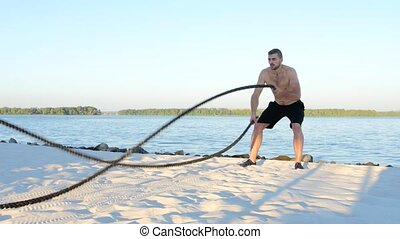 Man spends training with ropes, trained athlete, battle...