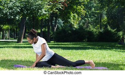 Exercising in nature. Yoga - Exercising in nature, woman...