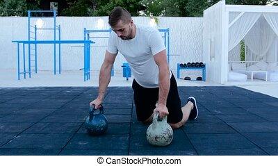 Man push-ups on dumbbells, trained athlete, man push-ups on...
