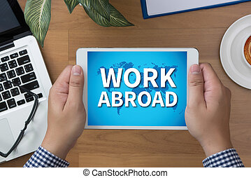 WORK ABROAD man hand Tablet and coffee cup