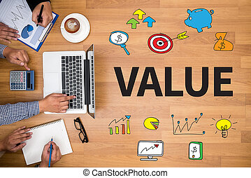 Value Business team hands at work with financial reports and...