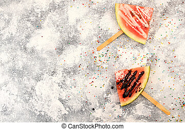 Slices watermelon in ice cream popsicle shape - Slices...