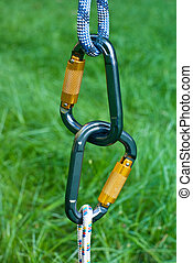 carabiners on a green grass background - two carabiners on a...
