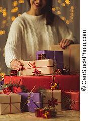 Ranging christmas presents - Woman is ranging christmas...