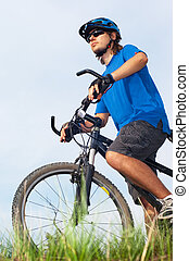 young bicyclist in helmet - young bicyclist in a blue helmet...