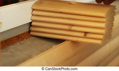 the man shifts the plank of wood