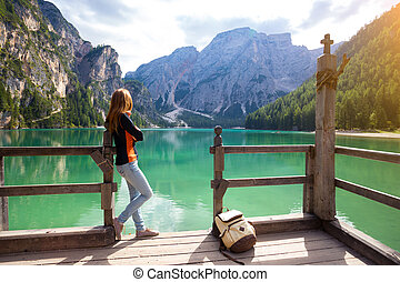 lago di Braies - girl and view of well-known tyrolean lake...