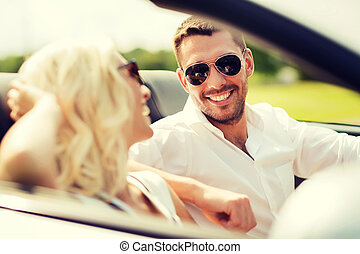 happy man and woman driving in cabriolet car - leisure, road...