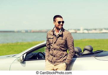happy man near cabriolet car outdoors - auto business,...