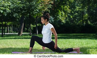 Woman doing yoga in the park on a beautiful day