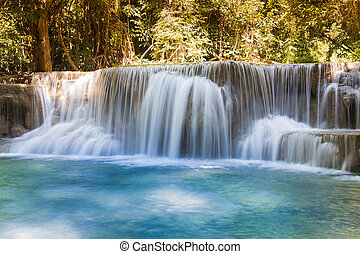 Blue stream waterfalls in deep forest national park of...