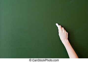 Blackboard - hand writing by chalk on a blackboard