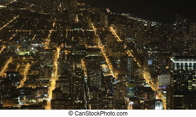 Wide aerial view after dark in Chicago