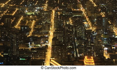 Wide aerial view of Chicago after dark