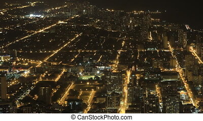 Wide aerial view after dark in Chicago, Illinois - A Wide...