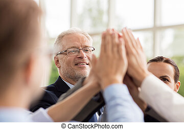 business people making high five in office - business,...