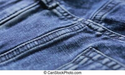 Blue jeans texture can use as background close-up of denim -...