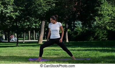 Young fit woman on yoga mat and taking selfie photo - Young...